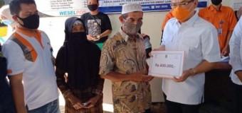 Bupati Joncik Hadiri Penyerahan BST di Kantor Pos Cabang Tebing Tinggi